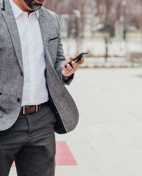 business-man-checks-mobile